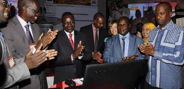 Deputy President (at the centre), during the launch of the Online Transactional Mining Cadastre Portal.